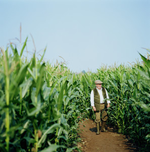 image of farmer and corn on origins of corn blog.